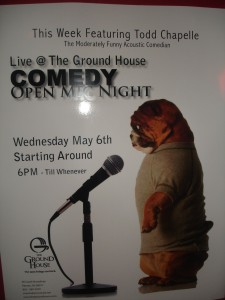 The poster for the comedy night. Note the dog.