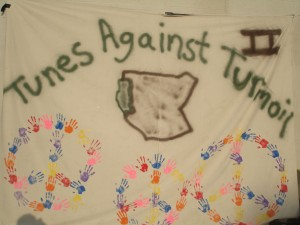 The Tunes Against Turmoil 2 Banner/Sign